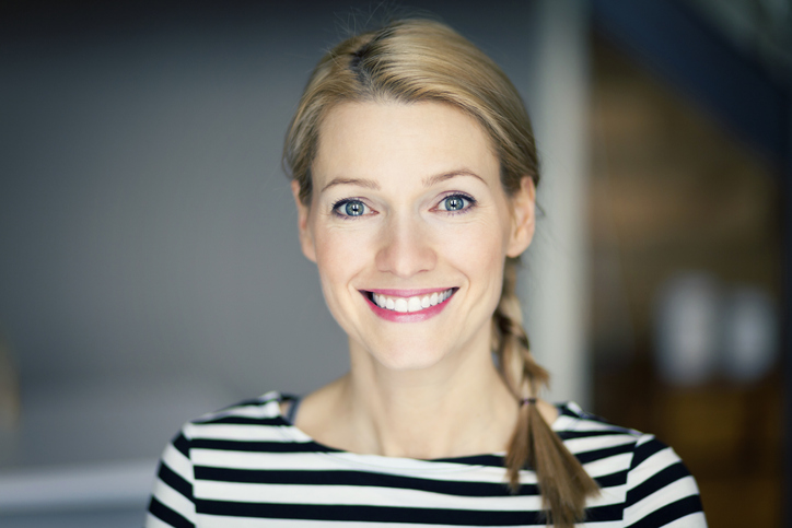 Smiling blond woman wearing a striped shirt